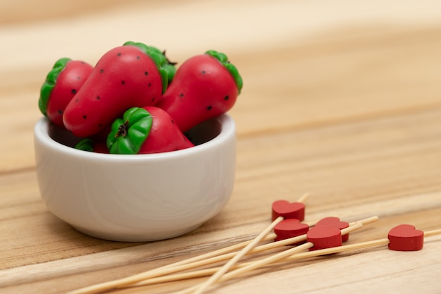 Strawberry shaped milk powder sweet on wood