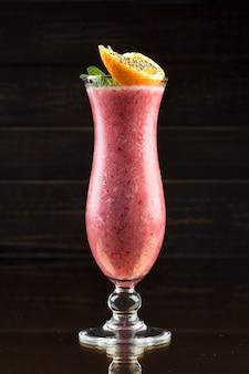 Strawberry smoothie on dark