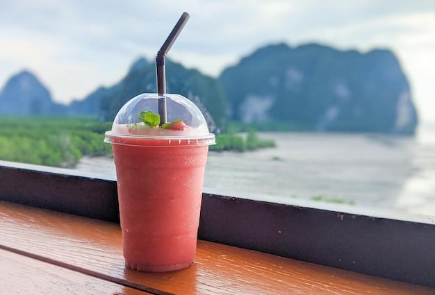 Strawberry smoothie on sea view