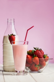 Strawberry smoothie on white wood