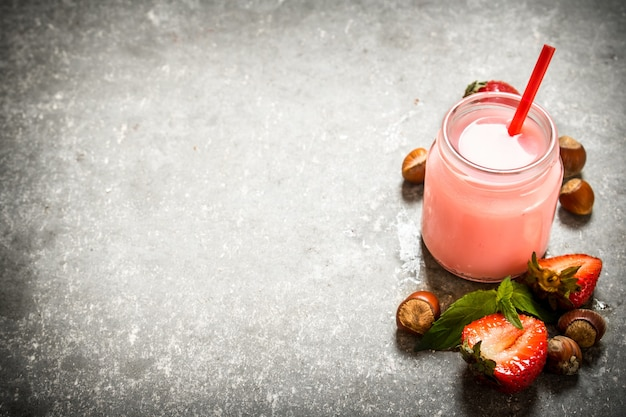 Strawberry smoothie with milk and nuts