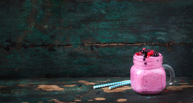 Strawberry smoothie with wooden background