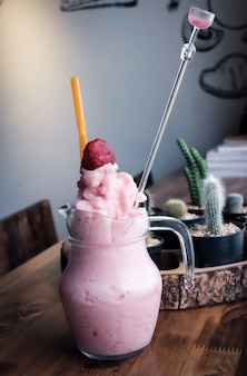 Strawberry smoothie on wooden table