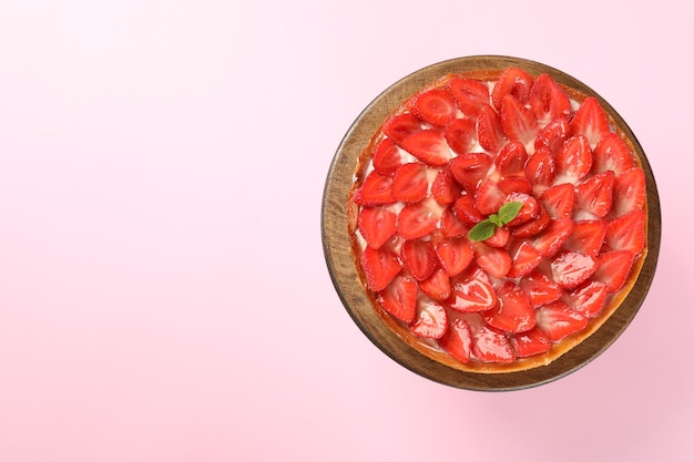 Strawberry tart on pink background, space for text.