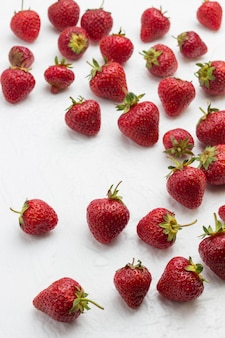 Strawberry on white surface. diet  food concept.