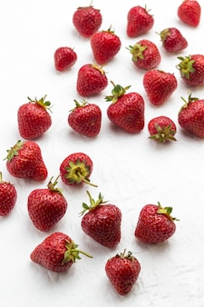 Strawberry on white surface