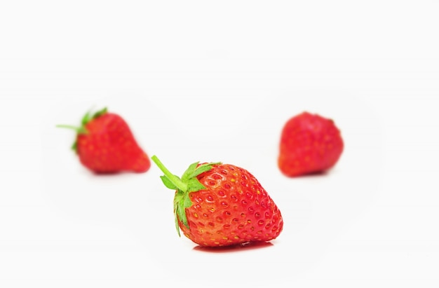 Strawberry on white wall