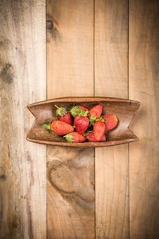 Strawberry on the wood