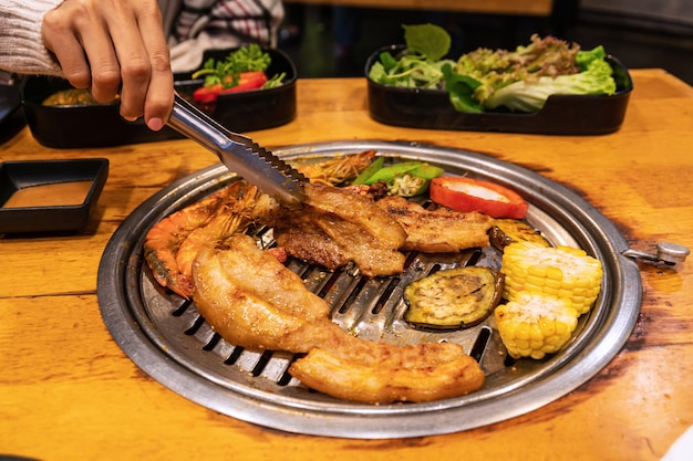 Streaky pork , shrimp and vetgetable on charcoal grill for barbecue korean or japanese style yakiniku.