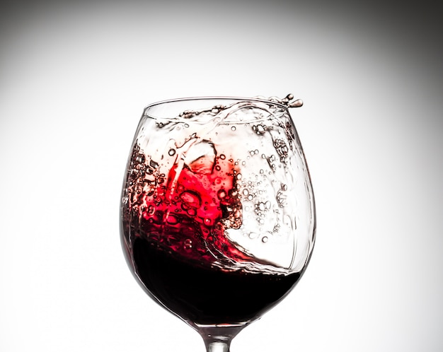 Stream of wine being pouring into a glass.