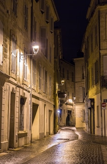 A street in avignon in france by night