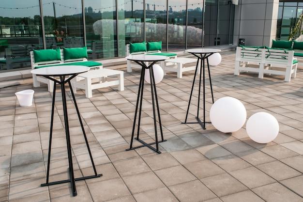 Street bar tables on the terrace