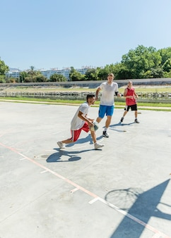 Street basketball players on the outdoors court