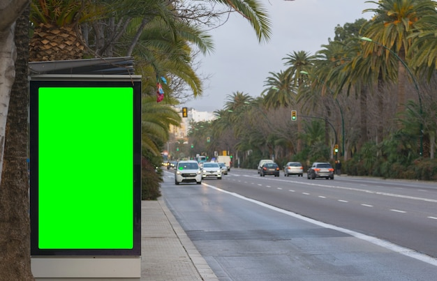 Street billboard sign with green screen, mock up of an outdoor billboard advertisement