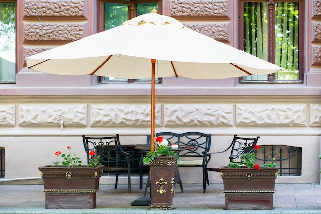 Street cafe under the big umbrella