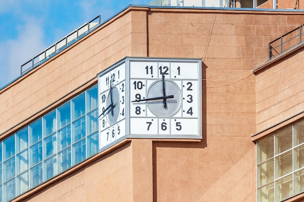 Street clock on building facade