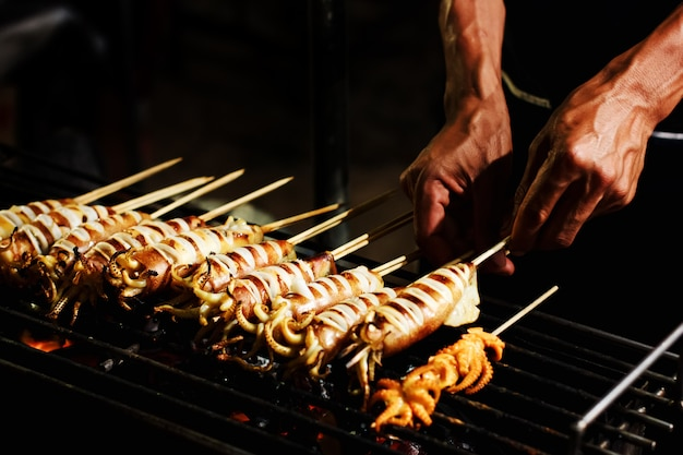 Street food preparing outdoors in asia