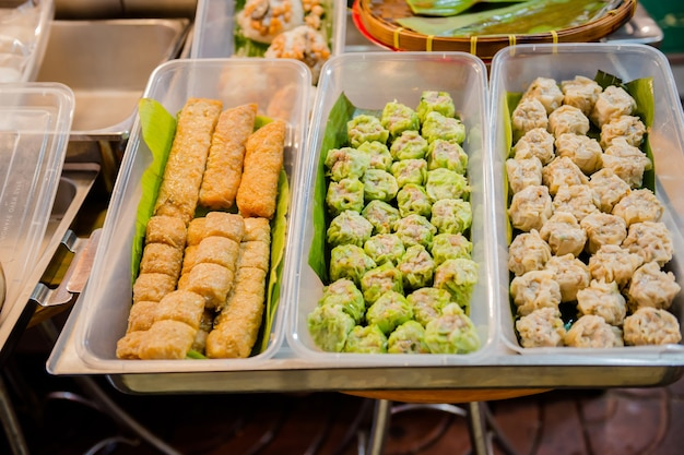 Street food at yaowarat road, chinatown, bangkok and sample delicious street food. there are seafood,