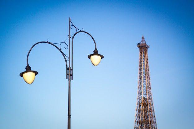 Street lamp on the background of the tower and the blue clear sky
