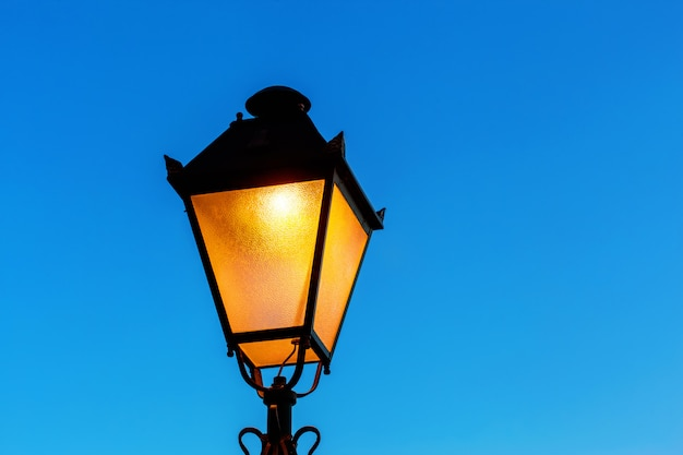 Street lamp at the blue sky background