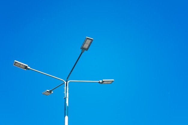 Street lamp with reflectors against the sky. energy saving technologies.