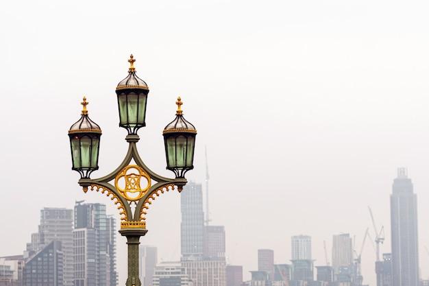 Street lamps on westminster bridge, blurred skyscrapers