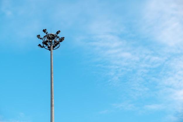 Street light pole on blue sky with cloud