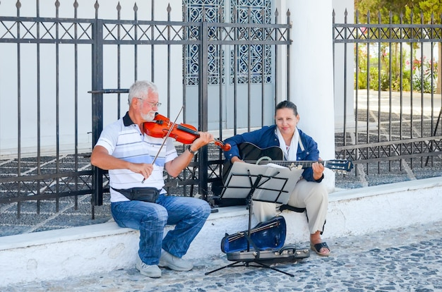 Street musicians play music for people on the streets.