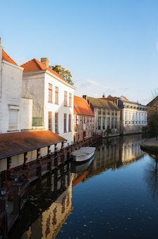 Street of old town  with canal waters, bruges, belgium