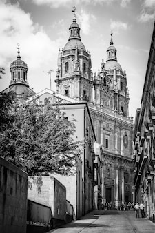 Street in salamanca with la clerecia church. in its end, spain.  black and white cityscape