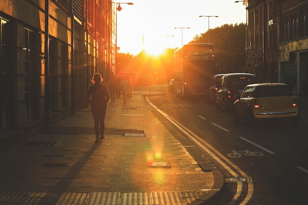 Street scene of people walking during the sunset on oxford street