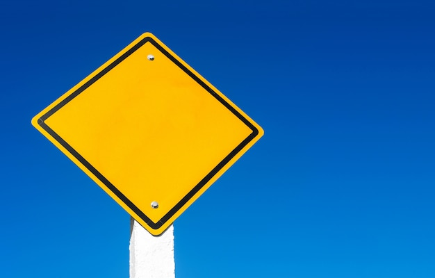 Street sign against blue sky