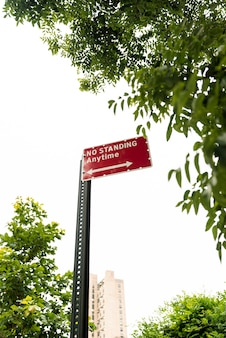 Street sign with blurred city background