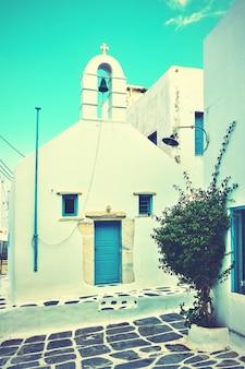 Street and small greek church in mykonos, greece. vintage style