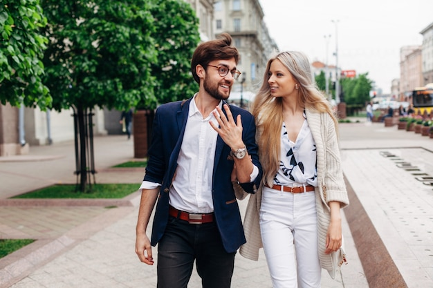 Street summer portrait of young beautiful sensual couple walking on the street in summer together