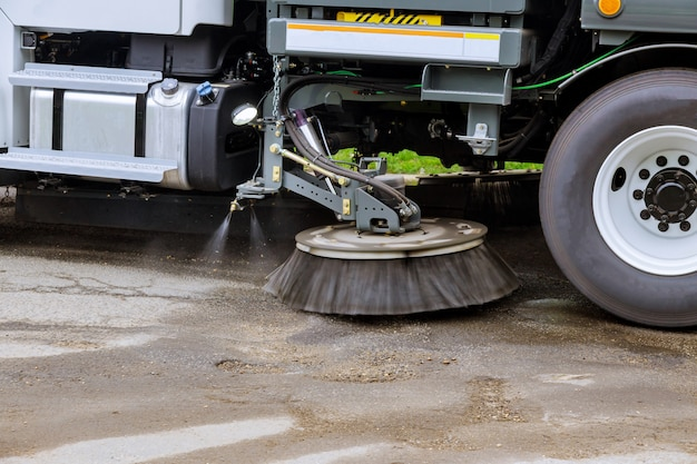 Street sweeper machine cleaning the streets in utility service of the town.