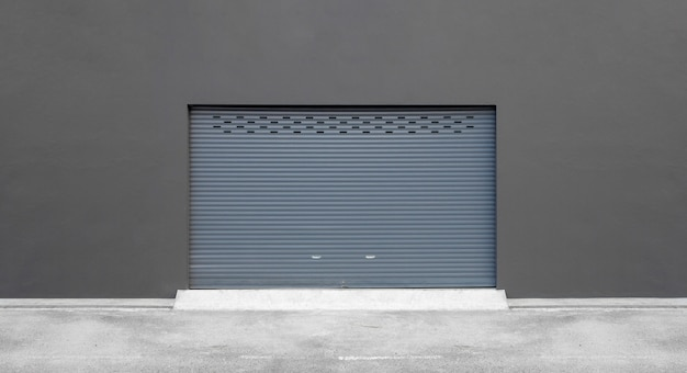 Street wall background. roller shutter door and concrete floor outside factory building for industrial