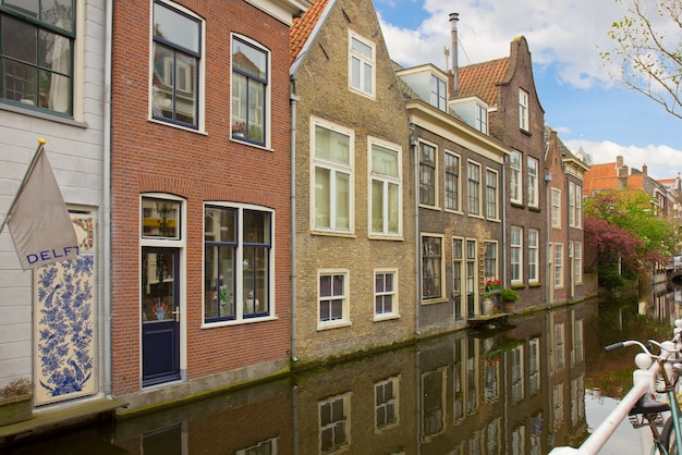 Street with canal in old town of delft in spring time, holland