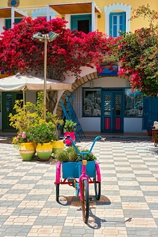 Street with colorful houses in adamantas town on milos island in greece