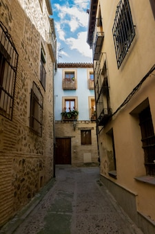 Streets and blue house of the city of toledo in spain.