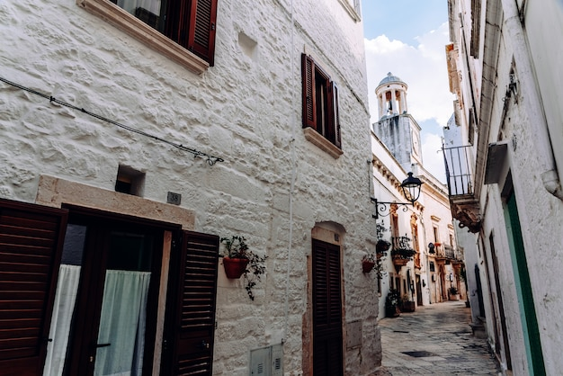 Streets with houses with whitewashed walls of the typical italian city of locorotondo.