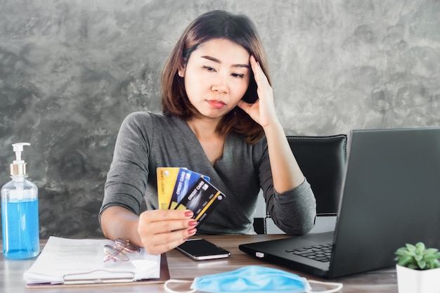 Stress asian woman with financial problem and debt