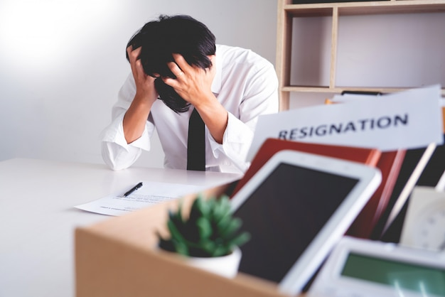 Stress businessman with resignation letter