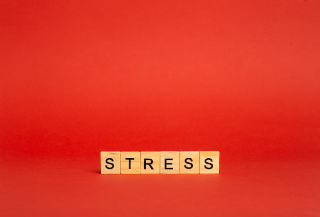 Stress concept. stress on a red empty background. a feeling of anxiety, tension, fear and anger