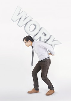 Stressed asian man carrying on his back shoulders large text work