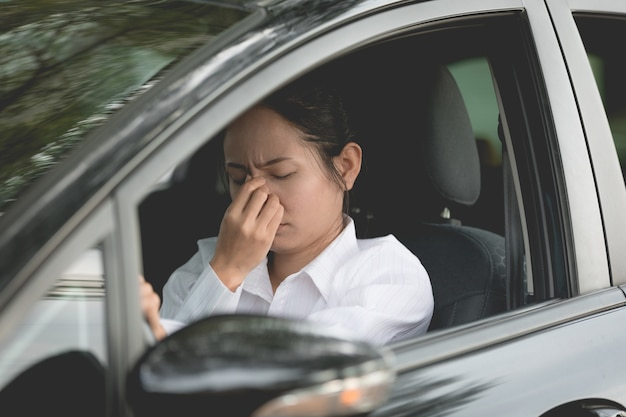 Stressed of asian woman driver sitting inside her car