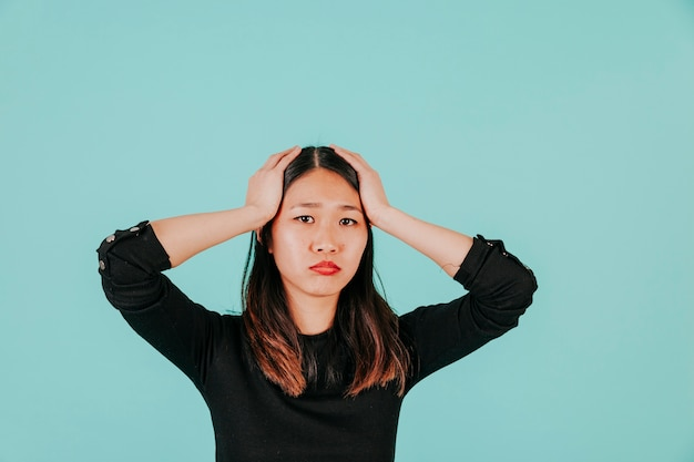 Stressed asian woman