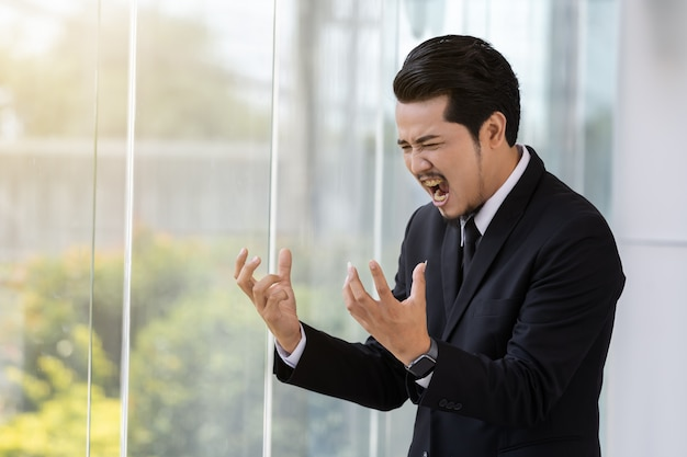 Stressed business man thinking about problem in office