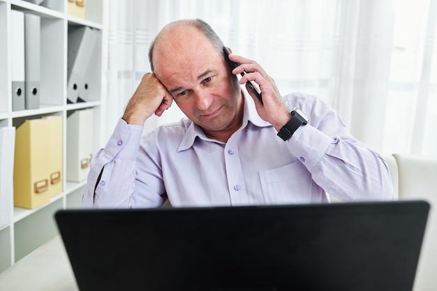 Stressed businessman talking on phone