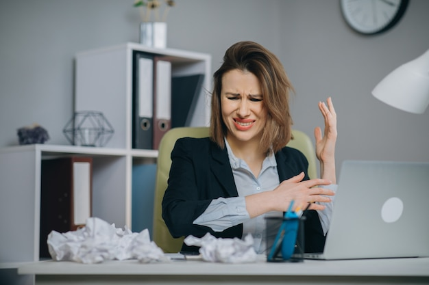 Stressed businesswoman annoyed using stuck laptop, angry woman mad about computer problem frustrated with data loss, online mistake, software error or system failure